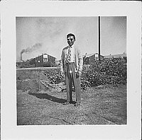 [Man with bandaged eye and sunglasses standing outside, Rohwer, Arkansas, November 2, 1944]