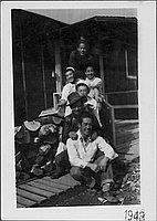 [Seven young men on barracks porch, Rohwer, Arkansas, 1943]
