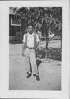 [Young man in vest stands in front of tree, Rohwer, Arkansas, October 10, 1944]