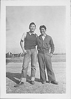 [Two young men standing in open area, Rohwer, Arkansas, 1942-1945]