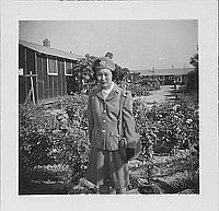 [Woman in United States Cadet Nurse Corps uniform standing in garden, partial portrait, Rohwer, Arkansas, September 23, 1944]