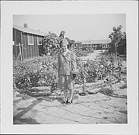 [Woman in United States Cadet Nurse Corps uniform standing in garden, full-length portrait, Rohwer, Arkansas, September 23, 1944]