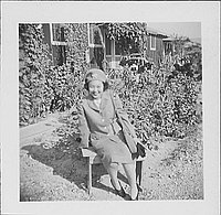 [Woman in United States Cadet Nurse Corps uniform sitting in garden, seated portrait, Rohwer, Arkansas, September 23, 1944]