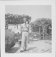 [Tetsu Ted Hasegawa in United States Army uniform standing in front of arbor, Rohwer, Arkansas, October 16, 1944]