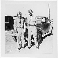 [Two men in United States Army uniform standing in front of automobile, Rohwer, Arkansas, August 20, 1944]