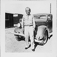 [Man in United States Army uniform standing in front of automobile, Rohwer, Arkansas, August 20, 1944]