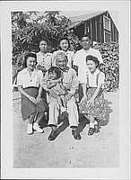 [United States Army soldier holding little girl amidst five people, Rohwer, Arkansas, August 20, 1944]