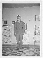 [Soldier in dress uniform in barracks, Rohwer, Arkansas, 1942-1945]