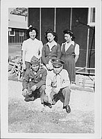 [Two soldiers and three women, Rohwer, Arkansas, February 11, 1945]