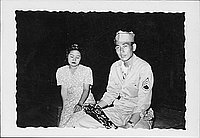 [United States Army staff sergeant and woman in floral dress, Rohwer, Arkansas]