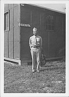 [United States Army soldier standing in front of Company A, 232nd Battalion building, October 1944]