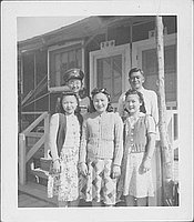 [United States Army soldier and four people in front of barracks unit, 2-3-D, Rohwer, Arkansas]