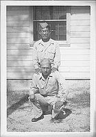 [Two United States Army soldiers, one crouching, one standing, October 1944]