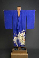 [Blue homongi (visiting kimono) with rose design over tone on tone arrow pattern, Ewa, Hawaii]