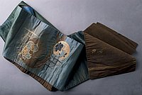 [Double-sided obi with brown bird design and brown and gold swirls on blue-green design]