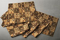 [Handwoven tubular honbukuro obi with black and brown checkered design of Chinese characters and landscape]