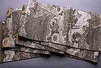 [Double-sided brocade obi with crane, pine, chrysanthemum and cherry blossom design]