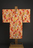 [Girl's red and peach silk kimono with plum blossom, chrysanthemum and bamboo design, Waipahu, Hawaii, ca. 1930]