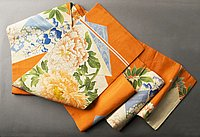 [Double-sided obi with peony design on orange background and blue flower design on light blue, 193-]