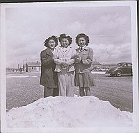 [Three girls standing in snow, Heart Mountain, Wyoming, 1943]