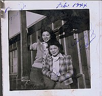 [Two young women in front of barracks, Heart Mountain, Wyoming, February 1944]