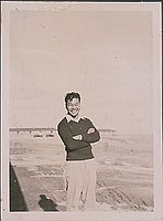 [Young man standing with arms crossed, Heart Mountain, Wyoming, 1944-1945]