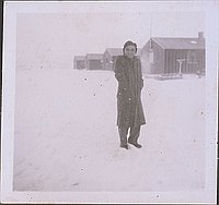 [Man in overcoat standing in snow, Heart Mountain, Wyoming, Winter 1944-1945]