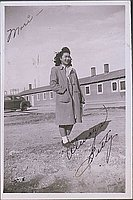 [Betty in overcoat in front of barracks and car, Heart Mountain, Wyoming, Winter 1944-1945]