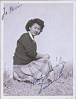 [Portrait of Sumie kneeling on grass, Heart Mountain, Wyoming, 1944]