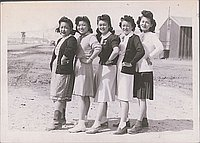 [L.A. girls and guard tower, Heart Mountain, Wyoming,