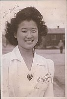 [Portrait of young woman, Mary, with heart shaped pin 225, Heart Mountain, Wyoming, ca. 1942-1945]