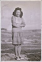 [Portrait of Marion Nida standing with arms crossed, Heart Mountain, Wyoming, 1944]