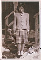 [Portrait of Mary in front of barracks steps, Heart Mountain, Wyoming, Winter 1944-1945]