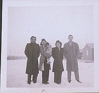 [Two couples and a child standing in snow, Heart Mountain, Wyoming, Winter 1944-1945]