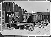 [After the end of World War II, internees brought out coal stoves from camp, ca.1945]
