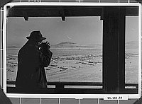 [Robert Ross photographing Tule Lake concentration camp from watchtower, Newell, California, ca. 1943]
