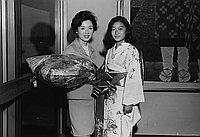 [Actress Yoshiko Sakuma and Mr. Okawa, President of Toei Movie Company at airport, Los Angeles, California, July 10, 1968]