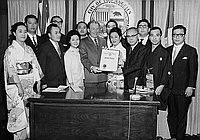 [Los Angeles Mayor Sam Yorty presenting proclamation to Osamu Shimizu at Los Angeles City Hall, Los Angeles, California, October 9, 1968]