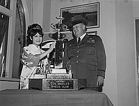 [Mari Hattori, Queen of Henry Oiye Trophy Race, with trophy, California, May 31, 1968]