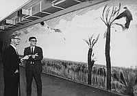 [Taro Yashima in front of Kagoshima Science Museum mural at Natural History Museum of Los Angeles, Los Angeles, California, February 25, 1969]