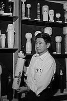 [Shigeru Nakamura and kokeshi dolls, Los Angeles, California, July 22, 1969]