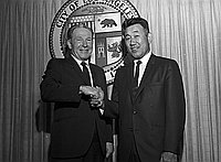 [Los Angeles Mayor Sam Yorty congratulating Tosh Terazawa, newly appointed President of Building Safety Commissioners, at Los Angeles City Hall, Los Angeles, California, August 21, 1969]