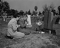 [Mr. and Mrs. Kiyohito Kawakami at Takejiro Kawakami's grave in Evergreen Cemetery, Los Angeles, California, March 21, 1951]