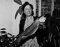 [Mrs. Amagusa and biggest catch in Sunrise Rising Club at Hirohata Insurance Office, Los Angeles, California, May 2, 1951]