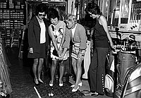 [Barbara Romack and three women golfers at L.A. Sporting Goods, Los Angeles, California, September 30, 1970]
