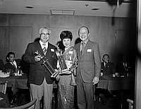 [Datsun Motors and the Miyoko Komori dancers receiving Santa Claus Lane trophies from Hollywood Chamber of Commerce at Imperial Dragon, Los Angeles, California, December 6, 1970]
