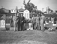 [Kyodo News Service staff next to Komai headstone at cemetery, Los Angeles, California, September 12, 1951]