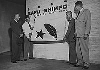 [Rafu Shimpo awarded Community Chest Red Feather flag, Los Angeles, California, November 7, 1951]