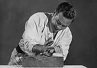 [Mas Togo, Karate instructor, demonstrates breaking rock, Los Angeles, California, July 18, 1952]