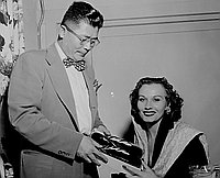[Teiho Hashida presenting Japanese zori to actress Florence Marley, Los Angeles, California, February 25, 1950]